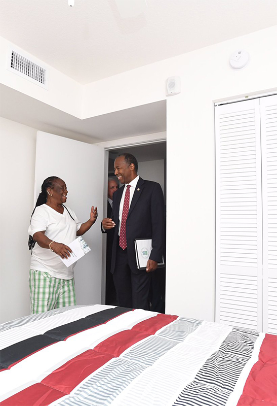 [Ms. Sharon Gregory the first resident to return to the brand new Liberty Square Phase I apartments, is visited by Secretary Carson]