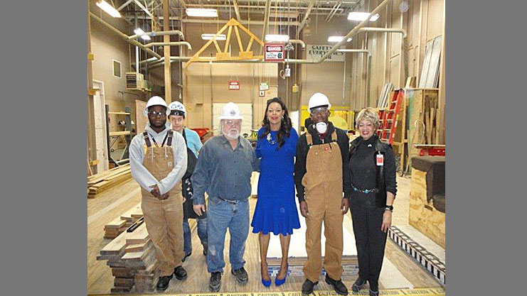 Regional Administrator Denise Cleveland-Leggett and HUD Field Office Director Sernorma Mitchell at Dr. Benjamin L. Hooks Job Corps Center with construction instructors and students. HUD Photo