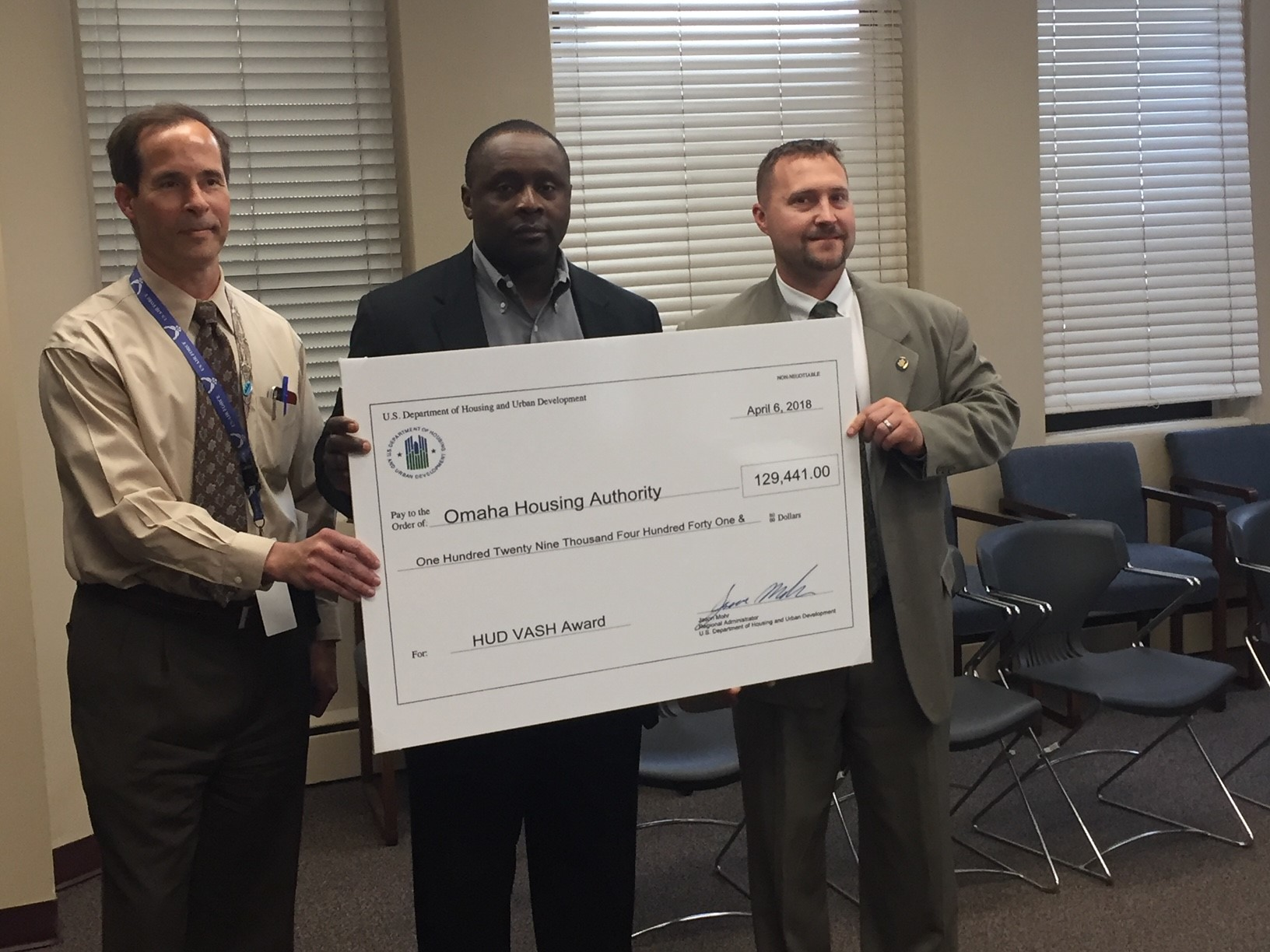 [Jason Mohr Presenting ceremonial check to local officials].