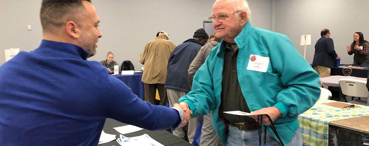 [Tim Nicolazzi of the HUD Kentucky Office provides assistance to a Veteran during the Veteran Stand Down Event in New Albany, Indiana]. HUD Photo