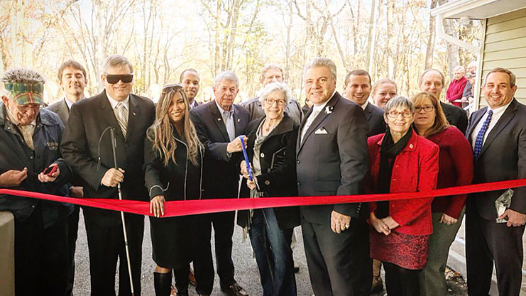 [HUD RA Patton and HUD NJ FOD Maio-Messano join developers, stakeholders, city and county officials at the ribbon cutting ceremony for the Jack and Barbara Tarditi Home]. HUD Photo