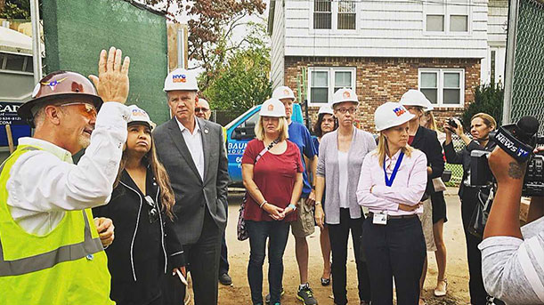 [HUD RA Patton, Staten Island Rep. Donovan, City and State officials take a look at a home elevation after Hurricane Sandy]. HUD Photo