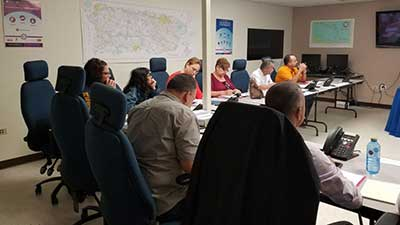[Interdisciplinary working groups shared experiences and resources in preparation to respond to disasters.]. HUD Photo
