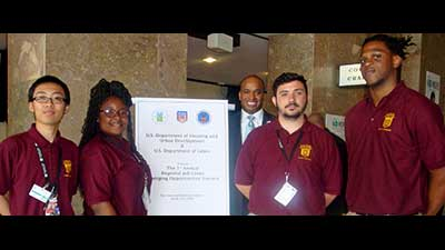 [Four Memphis Job Corps beneficiaries with Christopher Taylor, Region IV, Deputy Regional Administrator]. HUD Photo