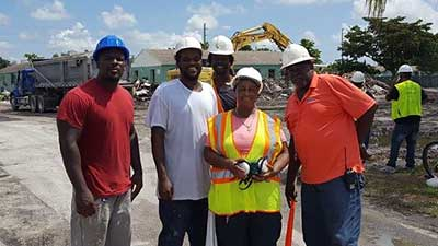 [Liberty Square residents and neighbors trained in several construction skills, now hired by RUNU to help with demolition of Liberty Square. From left, Henry Farmer, Leonard Johnson, Raphael White, Willie Phillips, Steve Lucien.]. HUD Photo