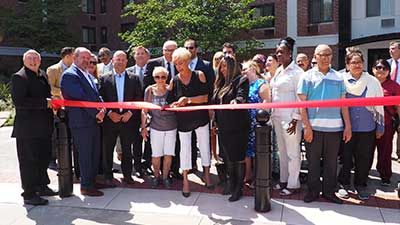 [Ribbon cutting ceremony at Elbee Gardens]. HUD Photo