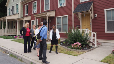 [Officials tour Habitat for Humanity houses]. HUD Photo