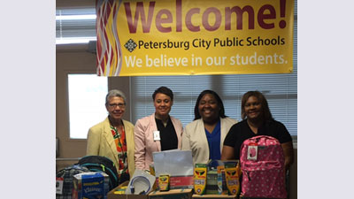 [Overseeing delivery of supplies are Toni Schmiegelow, Sheryl Doswell, Courtney Ward and Denise Greene]. HUD Photo