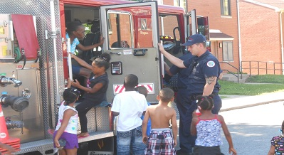 Kids learn about fire safety. HUD Photo
