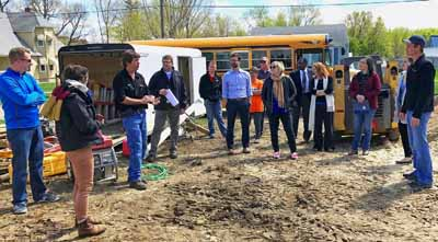 Community stakeholders on a tour of land in Randolph. HUD Photo