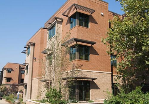 [3 story two-tone brick apartments]. HUD Photo