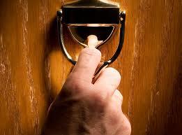 hand on door knocker. HUD Photo