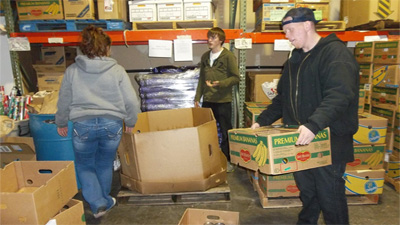 [Food bank volunteers working in the warehouse.]
