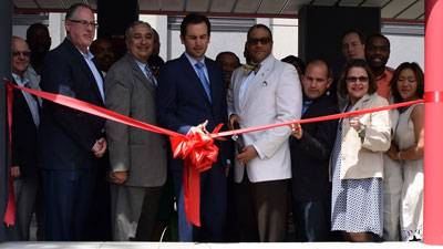 [The Michaels Organization's President of Development Gary Buechler, NJ HMFA Executive Director Anthony Marchetta, Jersey City Mayor Steven Fulop, Jersey City Housing Authority Executive Director Marvin Walton, and HUD D/Regional Administrator Mirza Orriols]