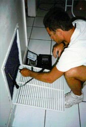 Photo: Clean air-conditioner coils regularly.