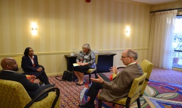FOD Earl Redrick (far left, RA Jennifer Tidwell (left center), and NIFA ED Tim Kinney (far right) with General Counsel for NIFA seated