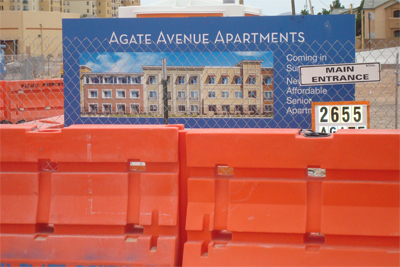 [Photo 2: Exterior view of Agate Avenue Apartments]