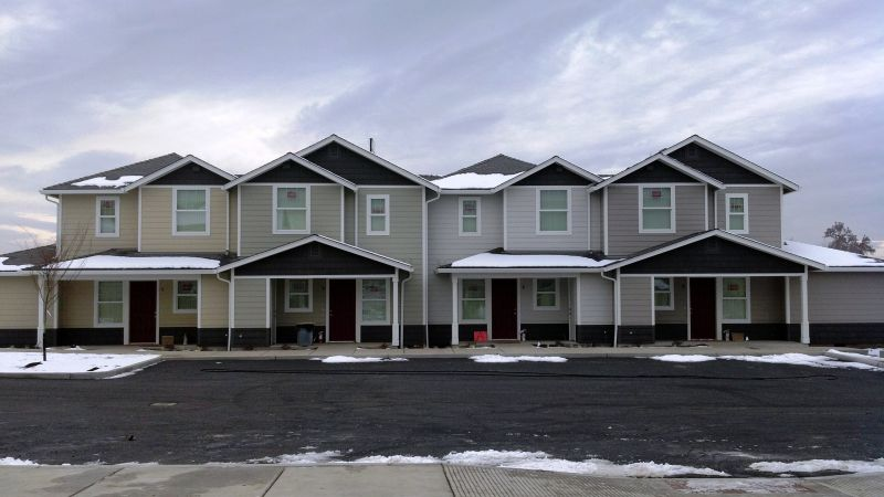 4 gray two story attached apartments