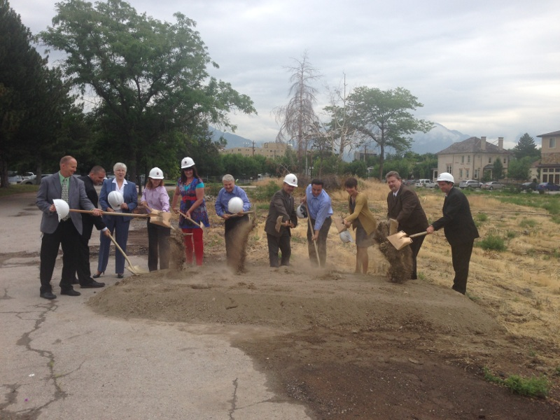 11 folks holding shovels at the Taylor Gardens Groundbreaking