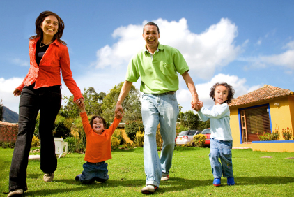 picture of family running on lawn