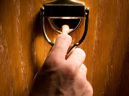 [hand on door knocker]