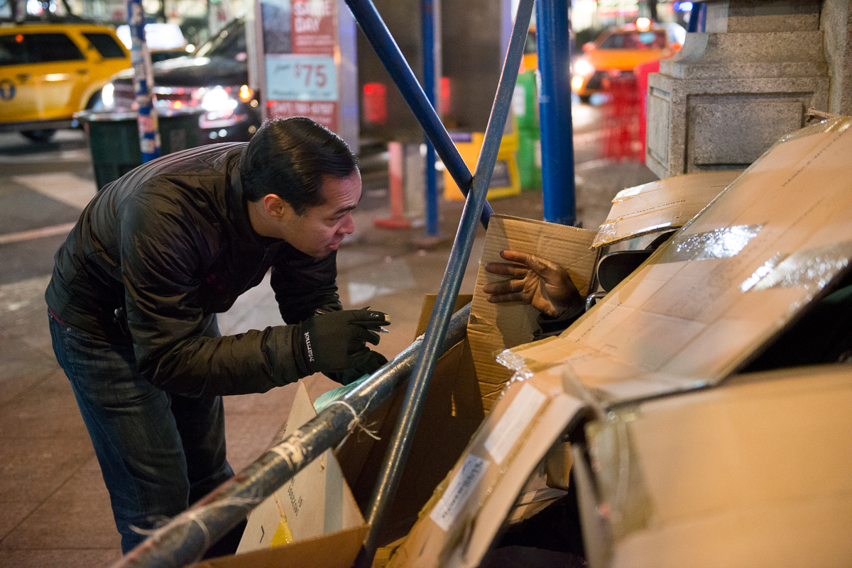 Man helping homeless on street