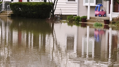Image of a flooded street/home
